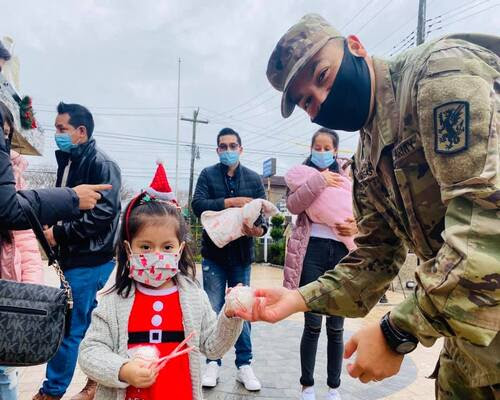 Soldiers and Santa Hold Annual Christmas Toy Distribution for Immigrant Families